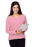 Mixed Indian woman use of tablet Stock Images