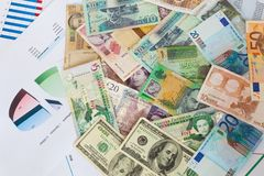 International money and graphs Stock Photography