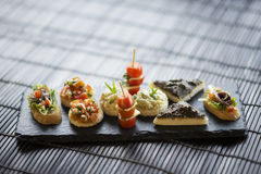 Mixed international tapas platter Stock Images