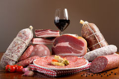 Italian cold cuts on brown background Royalty Free Stock Photography