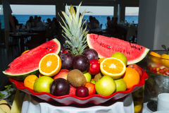Mixed juicy fruits in a platter. Stock Photos
