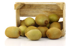Mixed kiwi fruit in a wooden crate Stock Image