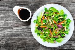 Mixed lettuce, spinach, carrot, ham, cheese and prunes salad , top-view Stock Images