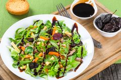 Mixed lettuce, spinach, carrot, ham, cheese and prunes salad , top-view Royalty Free Stock Photos