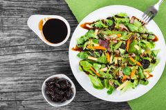 Mixed lettuce, spinach, carrot, ham, cheese and prunes salad , top-view Royalty Free Stock Images
