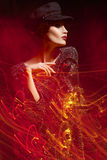 Mixed light fashion portrait of young woman. Royalty Free Stock Images