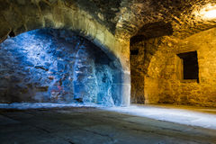 Mixed light in stone chamber Stock Photography