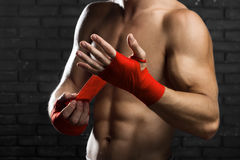 Mixed Martial Arts Fighter. Preparing Bandages For Training Royalty Free Stock Photography
