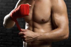 Mixed Martial Arts Fighter. Preparing Bandages For Training Stock Photography