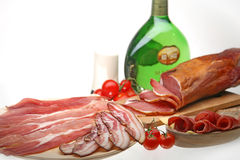 Mixed meat. Mixed dried meat, bacon, ham with vine Royalty Free Stock Photo