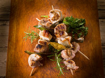Mixed meat skewer on wooden Royalty Free Stock Photo