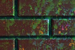 Mixed media artwork, abstract colorful artistic painted layer in brown, green color palette on grunge brick wall texture photograp stock photography