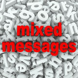 Mixed Messages Poor Communication Misunderstood. The words Mixed Messages on a background of random letters and words to illustrate poor communication or a bad Royalty Free Stock Image