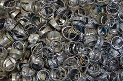 Mixed metallic rings tangled pile Stock Photos
