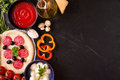 Mixed mexican food background. Party food. Guacamole, nachos, fajita, meat tacos, salsa, peppers, tomatoes on a wooden table. Space for text. Top view. Tex-mex Stock Image