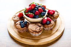 Mixed muffins fruits on wooden board Royalty Free Stock Photography