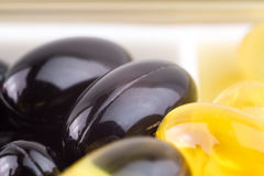 Mixed natural food supplement pills, vitamin a, carotene, omega 3, vitamin e, capsules macro image. Stock Photos