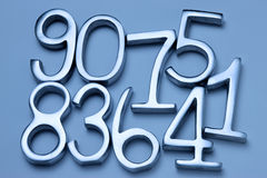Mixed Number Background. Metal numbers on a blue background Royalty Free Stock Photos