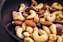 Mixed nut. S are a snack food consisting of any mixture of mechanically or manually combined nuts Stock Photo