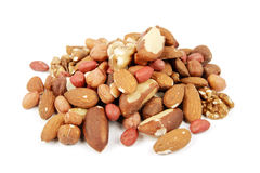 Mixed Nuts. Assorted mixed nuts on a reflective white background Royalty Free Stock Images
