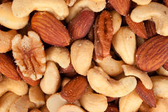 Mixed nuts. Including almonds, cashews, hazelnuts and walnuts sprinkled with salt Royalty Free Stock Photography