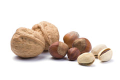 Mixed nuts. Collection isolated on a white background. Walnut, Hazelnut and Pistachio stock photos