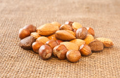 Mixed nuts. On hessian surface Royalty Free Stock Images