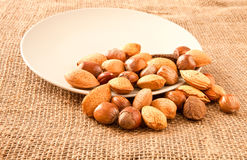 Mixed nuts. On hessian surface Stock Photo