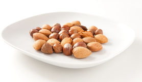 Mixed nuts. On a plate Stock Photography