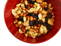Mixed nuts. Red bowl of mixed nuts Royalty Free Stock Photos