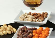 Mixed nuts. And cup of brandy Stock Image