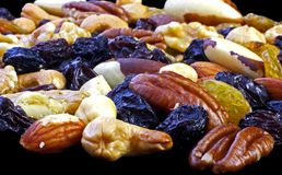 Mixed nuts. Isolated on black, can be used as background Stock Photos