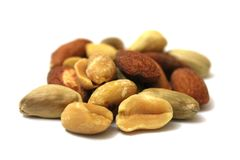 Mixed Nuts. Background of mixed nuts - hazelnuts, walnuts, almonds, pine nuts stock photos