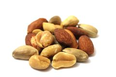 Mixed Nuts. Background of mixed nuts - hazelnuts, walnuts, almonds, pine nuts stock photo