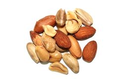 Mixed Nuts. Background of mixed nuts - hazelnuts, walnuts, almonds, pine nuts stock image