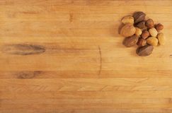 Mixed Nuts on Butcher Block Royalty Free Stock Images