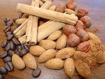 Mixed nuts, cinnamon & coffee Stock Images