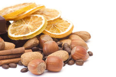 Mixed nuts, cinnamon, coffee beans and oranges Stock Photo