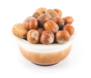 Mixed nuts in a cup. On a white background Royalty Free Stock Images