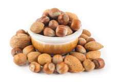 Mixed nuts in a cup. On a white background Stock Photo