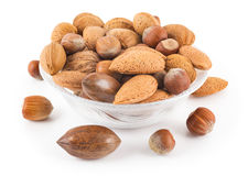 Mixed nuts in a cup. On a white background Royalty Free Stock Photo