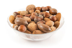 Mixed nuts in a cup. On a white background Stock Images