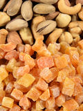Mixed nuts and dried apricots Stock Photo