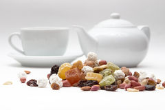 Mixed nuts and dried fruit in the background the Royalty Free Stock Images