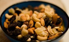Mixed nuts and dried fruits. Bowl of mixed nuts and dried fruits Stock Photography