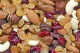 Mixed nuts and dried fruits. Delicious and healthy dried fruits and nuts Stock Photos