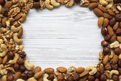 Mixed nuts frame. Cashew, hazelnuts, walnuts, almonds. Top view. Mixed nuts frame.Top view stock images