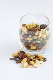Mixed Nuts in a glass and a heap on floor. Royalty Free Stock Photo