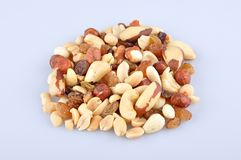 Mixed nuts. Heap of mixed nuts isolated on light blue background stock photo