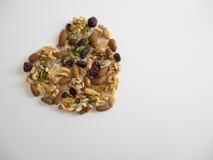 Mixed Nuts in Heart Shape. Mixed Nuts of Walnut, Sun Flower Seeds, Hazelnut, Peanut, Raisins in Heart Shape Stock Photo